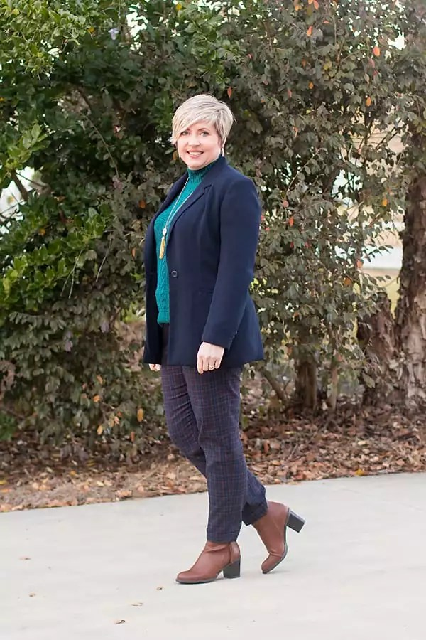 women's winter outfit with navy blazer, plaid pants and teal green sweater