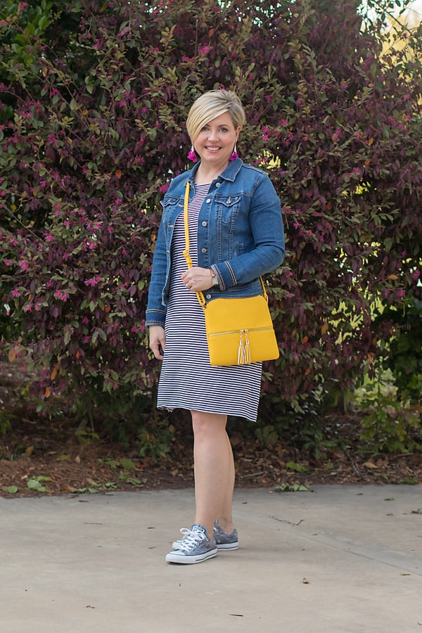denim jacket with stripe dress and sneakers
