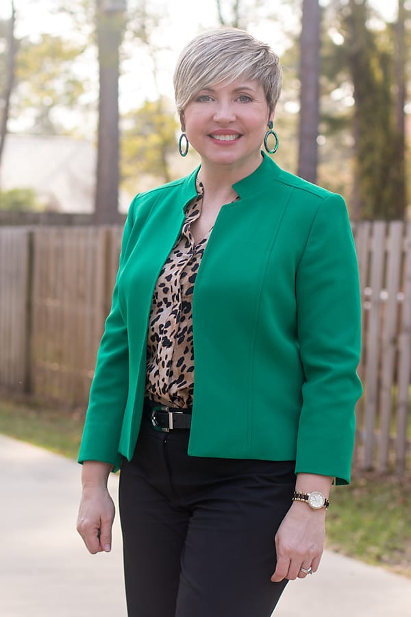 green collarless jacket with leopard blouse
