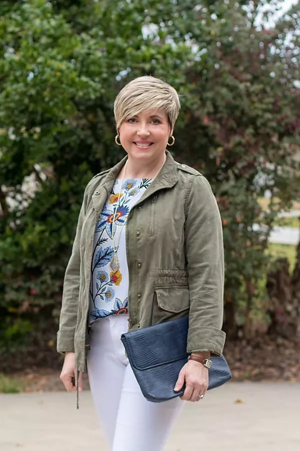 fashion blogger in utility jacket and hoop earrings