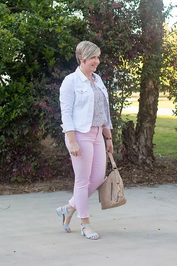 colored jeans for spring with white denim jacket