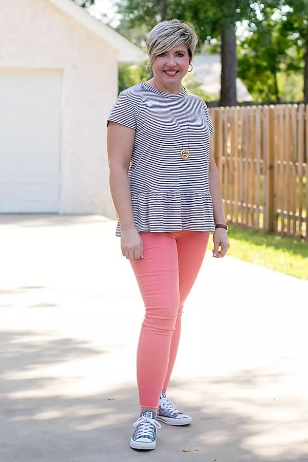 preppy outfit with peplum tee, coral jeans and grey sneakers