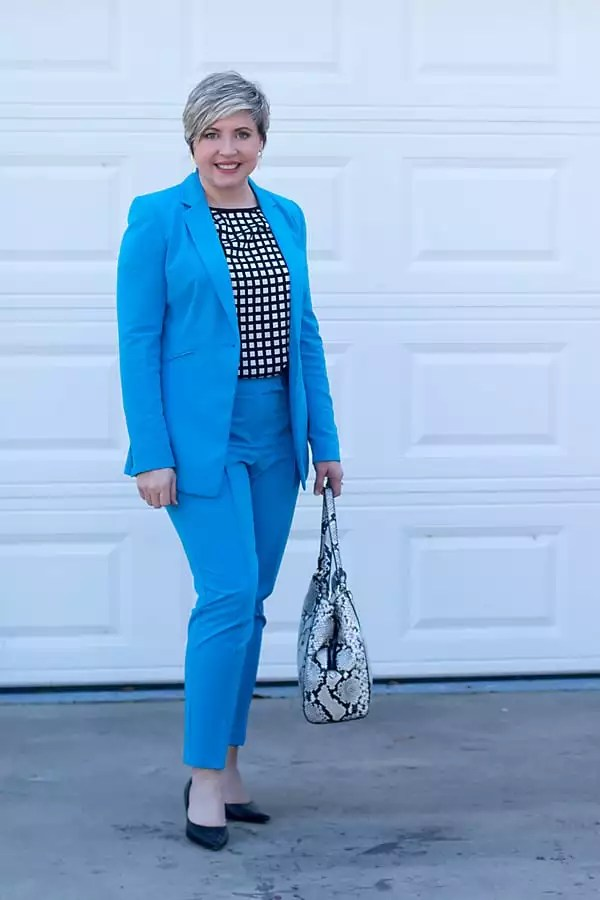 blue suit with black and white