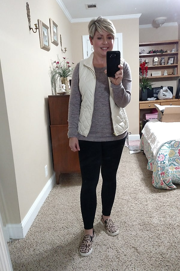 puffer vest with leggings and leopard sneakers atheleisure outfit