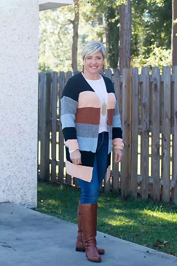 riding boots and cardigan outfit