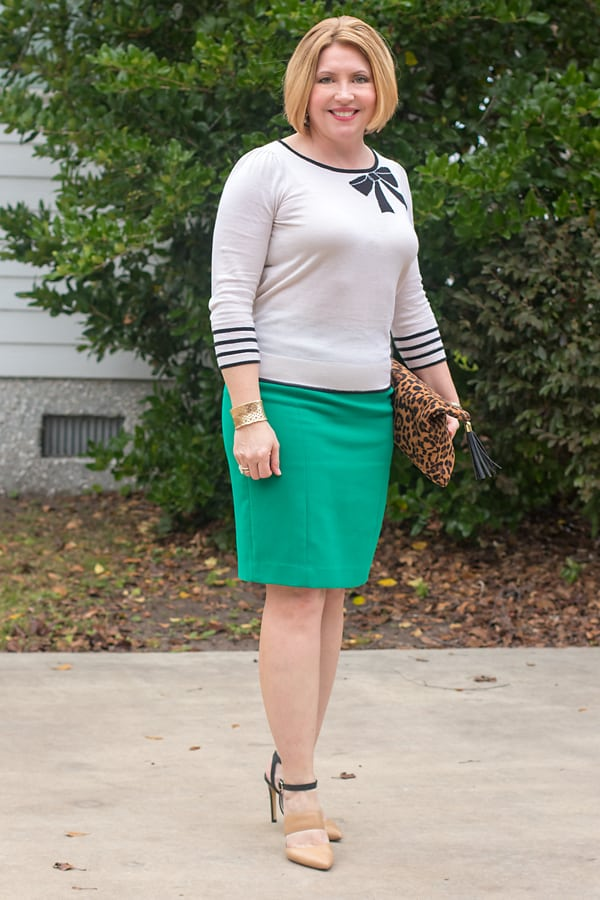 bow sweater and green pencil skirt Christmas outfits that aren't red and black