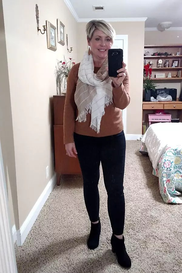 camel sweater and black jeans