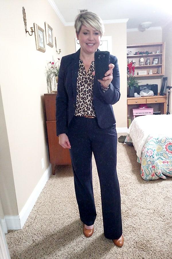 navy suit with leopard blouse
