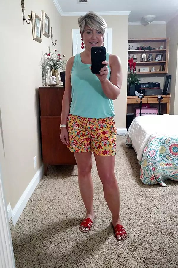 summer shorts outfit with statement earrings