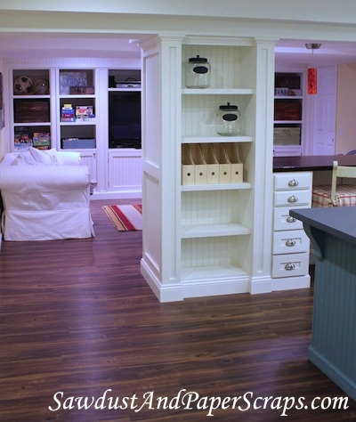 Spacious built in storage cabinets in craft room.