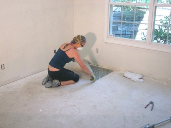 Cut into sections before you remove carpet.