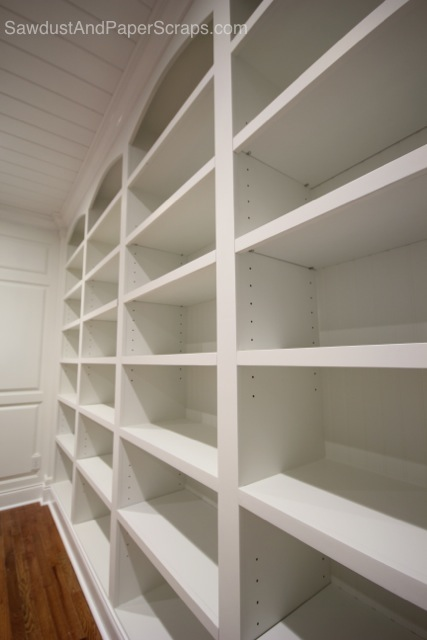 library with white built ins and wainscoting