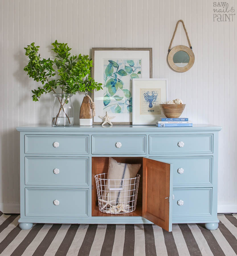 persian blue and snow white painted dresser with open storage saw