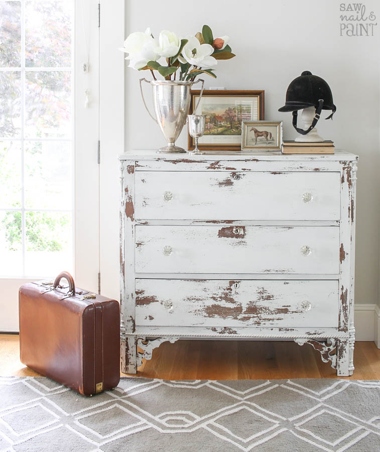 White Chippy Farmhouse Dresser With Glass Knobs And Trophy Cups