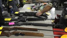 Dealer displays firearms for sale at a gun show in Kansas City
