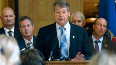 """North Dakota Attorney General Wayne Stenehjem, center, announces on 6-29-2015 at the state Capitol in Bismarck, the state joining attorneys general from 11 other states in a lawsuit against the Environmental Protection Agency and the U.S. Army Corps of Engineers over the EPA's new rule defining """"Waters of the United States"""" under the Clean Water Act. Second from the left is North Dakota Agriculture Commissioner Doug Goehring. 6-29-2015"""