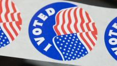 I Voted stickers await voters at Grand Forks polling sites Tuesday.    photo by Eric Hylden/Grand Forks Herald