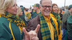 NDSU president Dean Bresciani gives the horns sign before the team arrives Saturday, Jan. 5, 2013 outside of FC Dallas Stadium in Frisco, Texas. David Samson / The Forum