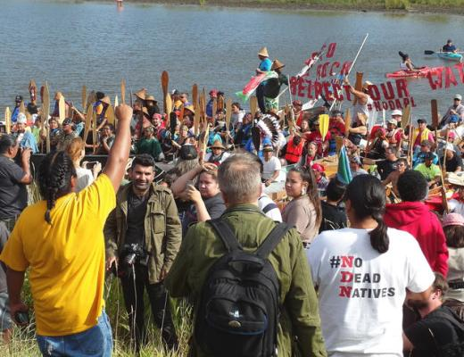 """Campers greet """"water protectors"""" who completed a two-day canoe trip and arrived where Dakota Access Pipeline opponents are caming north of Cannon Ball, N.D., on Thursday, Sept. 8, 2016. Amy Dalrymple/Forum News Service"""