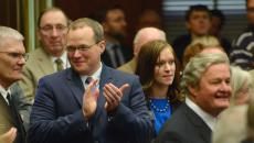 Senate Minority Leader, Mac Schneider, and Rep. Kylie Oversen welcome Gov. Jack Dalrymple before the State of The State Address on Tuesday, Jan 6, 2015, at the State Capitol in Bismarck, N.D. (Logan Werlinger/Grand Forks Herald)