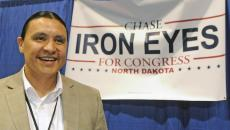 TOM STROMME/Tribune Chase Iron Eyes speaks at his booth at the 2016 North Dakota Democratic-NPL state convention where he is seeking the party's nomination for Congress. The convention continues Saturday in Bismarck.