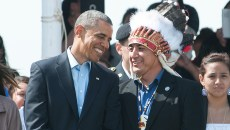 President Barack Obama smiles with David Archambault II, Standing Rock Sioux Tribe Leader, after entering the Cannonball pow wow grounds at the start of the Cannonball Flag Dag Celebration on Friday, June 13, 2014. (Kevin Cederstrom/Forum News Service)