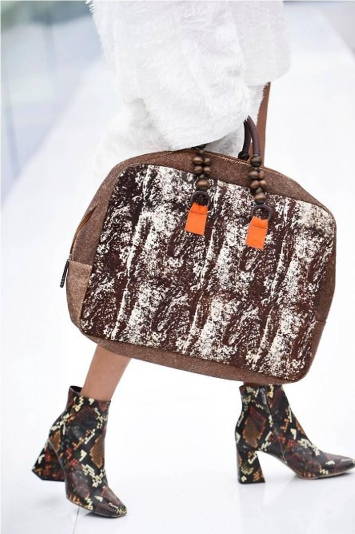 حقيبة فلاينج سولو بنية اللون