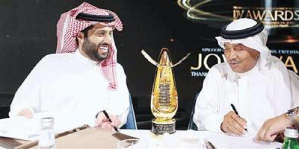تركي آل الشيخ ومحمد عبده من توقيع العقد