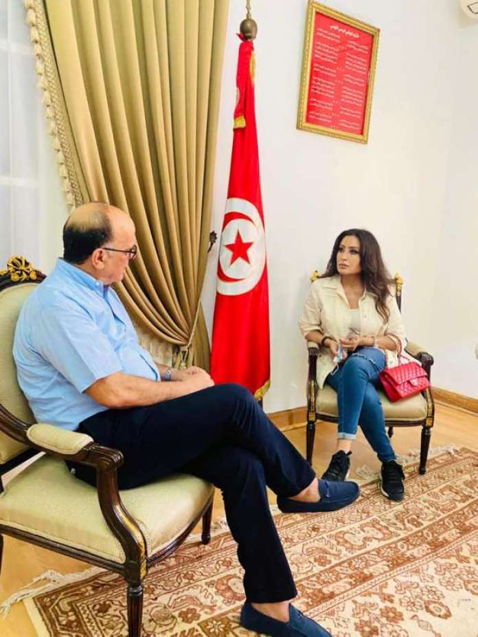 Latifa Al-Arfawi in an interview with the Tunisian ambassador to Egypt Photo from the official website of Latifa on Facebook.jpg