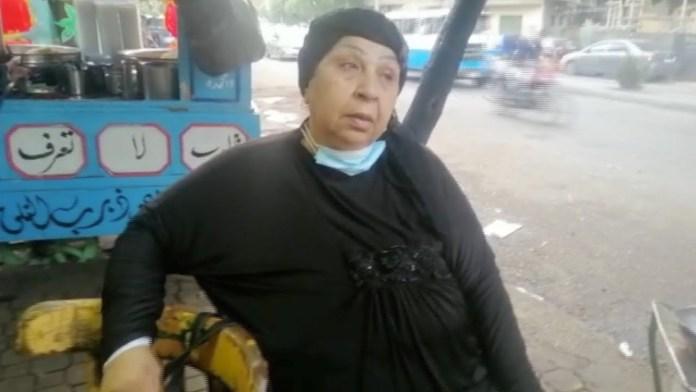 Fatima Koshary next to the famous Koshary cart