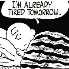 "charlie brown lying awake in bed with the caption , ""I'm already tired tomorrow."