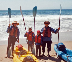 kayaking family on beach