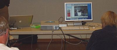 Can you find the Mac Mini or the iPod Shuffle? Point to items on the table to see what they are. (Photo: Brian Carlin)