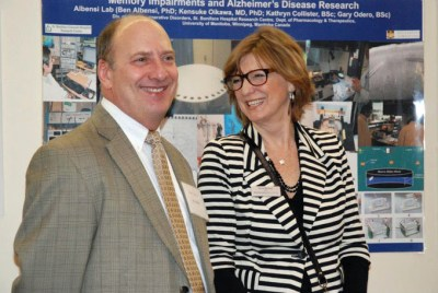 Dr. Ben Albensi with Chief Executive Officer of the Alzheimer's Society of Manitoba, Sylvia Rothney