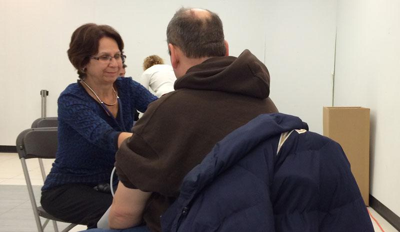Nurse checks for high blood pressure