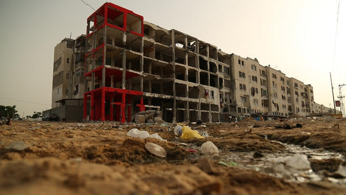 This street scene shows the damage to buildings in Gaza. Many others are riddled with bullet holes.