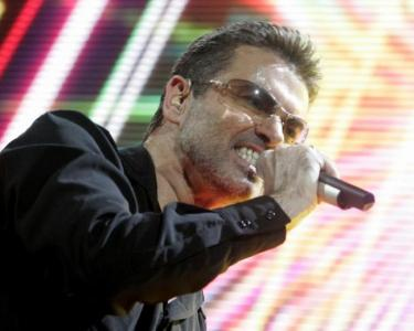 "FILE PHOTO: Singer George Michael performs on stage during his ""25 Live"" world tour at the Bercy stadium in Paris"