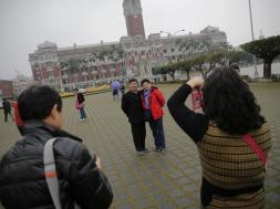 Tourists from China take pictures of themselves in front of the presidential palace in Taipei, Taiwan ahead of the elections