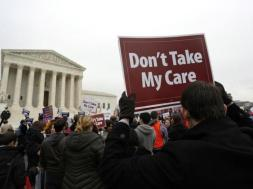 Demonstrators in favor of Obamacare gather at the Supreme Court building in Washington