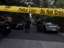A yellow police tape and a police cruiser block off the street leading to the house of Andrew Getty, the grandson of Getty oil founder J. Paul Getty, in the Hollywood Hills section of Los Angeles