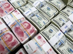 A file photo shows the  U.S. dollar and Yuan notes at the Korea Exchange Bank in Seoul