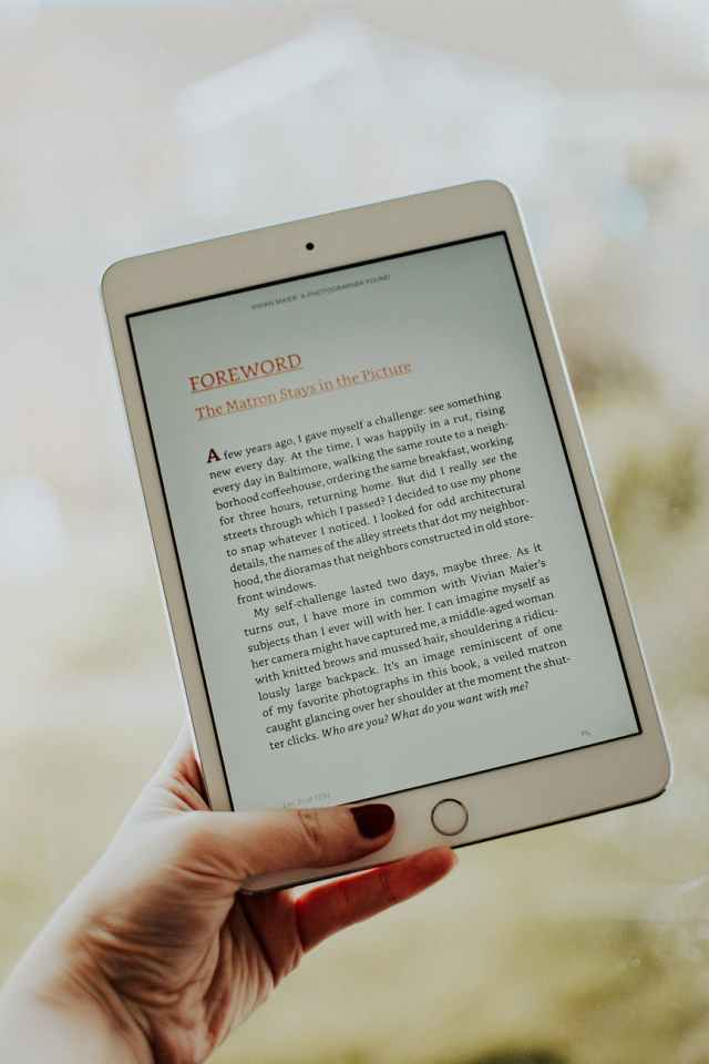 generate passive income online by writing an ebook - photo of person s hand holding ipad