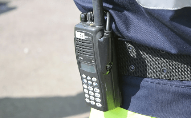 Healthcare workers use walkie talkie to communicate easily to each other