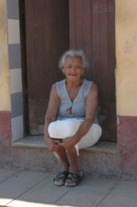 A Cuban woman watching the world go by