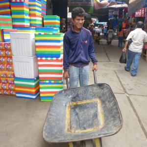 Wheelbarrow boy for hire