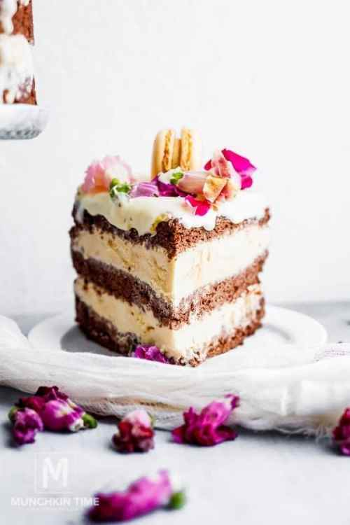 ice cream cake with pink flowers on white plate