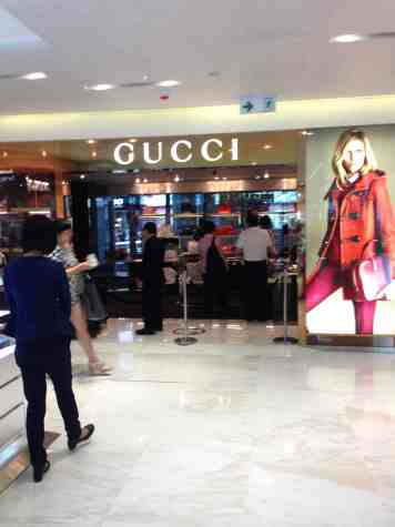 Gucci is surrounded by velvet ropes to prevent the common people from interacting with their big shot clients. Unlike in the US, when people in Asia buy luxury goods, it isn't by the item, but by suites of products. (Photo Courtesy of Tung)