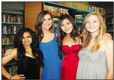 Parul Guliani, '11, Nicole Antoine '11, KJ Park ,'11, and Lauren Taylor, '11, in Matthews Library before graduation in June).