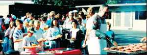 Stan Lake, father of Elizabeth Lake, '92, works on the grill at the event.