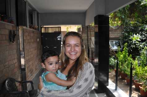 Senior Madison Judd holds an orphaned girl from Unique Home, a girls' orphanage in Jalandhar in India.